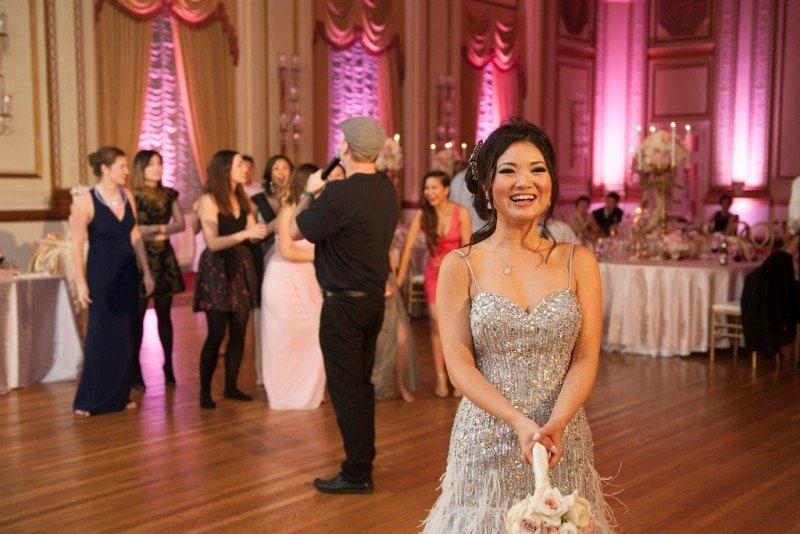 hotel-vancouver-wedding-bride-bouquet-toss-evening-gown